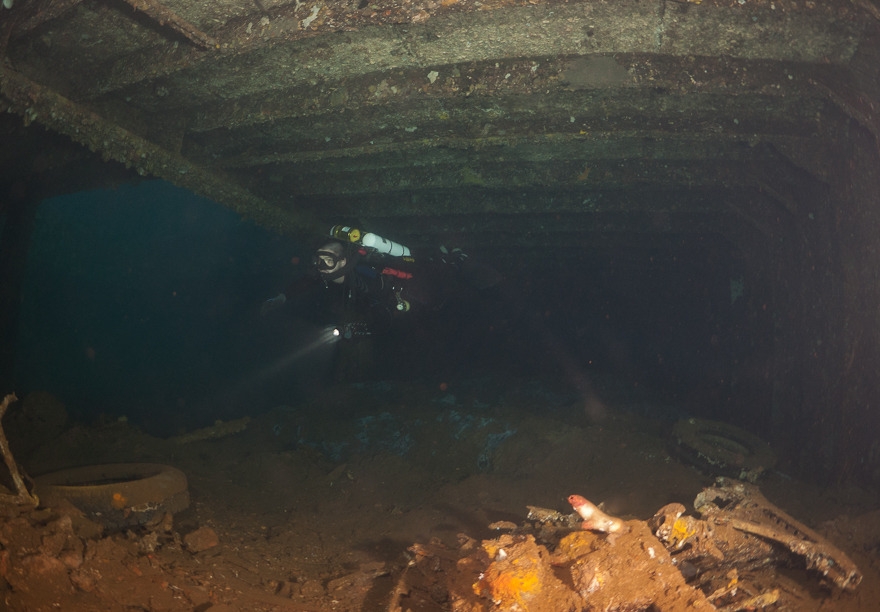 Remains of a car and a distant Rick inside the Kyokuzan Maru