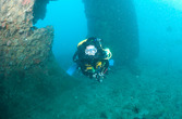 Michelle at the rudder of the Okinawa Maru